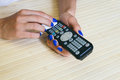 Female hands wipe dust remote control Royalty Free Stock Photo