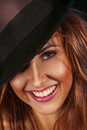 Female on hat and toothy smile in studio Stock Images