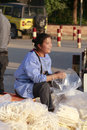 Female hawker selling expanded food by the road amoy city china Stock Photography