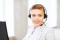 Female helpline operator with headphones business communication and call center Stock Images