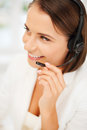 Female helpline operator with headphones business communication and call center concept Royalty Free Stock Photography