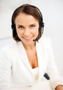 Female helpline operator with headphones business communication and call center concept Stock Photo