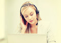 Female helpline operator with laptop Royalty Free Stock Photo