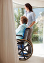 Female with her mother on the wheelchair Stock Image