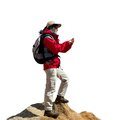 Female hiker consulting map on smart phone in winter wear gps isolated white background Royalty Free Stock Photos