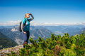 stock image of  Female hiker on the edge of hill looking at view