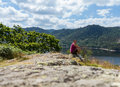 Female hiker overlooking thirlmere young in english lake district in lakeland cumbria Royalty Free Stock Photo