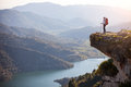 Female hiker standing on cliff Royalty Free Stock Photo