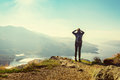 Female hiker on top of the mountain Royalty Free Stock Photo