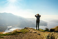 Female hiker on top of the mountain enjoying valley view Royalty Free Stock Photo