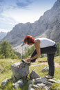 Female hiker tying boot laces Royalty Free Stock Photo