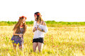 Female hippies in field Royalty Free Stock Photo