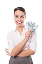 Female holding a fan of money over white background Royalty Free Stock Photography