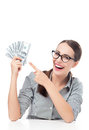 Female holding a fan of money young woman over white background Royalty Free Stock Photography