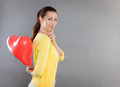Female holding secret heart as symbol Stock Image