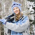 Female holding skis. Stock Photo