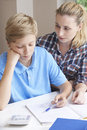 Female Home Tutor Helping Boy With Studies Royalty Free Stock Photo