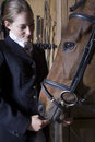 Female horseback rider with horse closeup of a young Stock Images