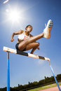 Female hurdler in action Royalty Free Stock Photo