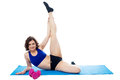 Female instructor doing her aerobic routine gym enacting over white background Royalty Free Stock Image