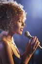 Female jazz singer on stage closeup profile of a Stock Image