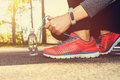 Female jogger tying her running shoes Royalty Free Stock Photo