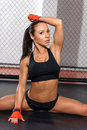 Female kickboxer poses at a ring Royalty Free Stock Photo