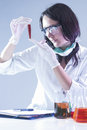 Female Laboratory Worker Looking at Flask Filled With Liquid Chemical During Experiment Royalty Free Stock Photo