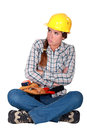 Female laborer blowing whilst sat down Stock Images