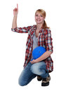 Female labourer with her hand up Royalty Free Stock Images
