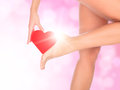 Female legs against a pink background with blurred lights Royalty Free Stock Photos