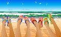 Female legs in colored flip flops against the sunny beach Royalty Free Stock Image