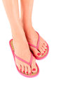 Female legs with flip-flops Royalty Free Stock Photos