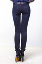 Female legs in jeans Royalty Free Stock Photo
