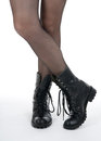 Female legs in pantyhose and black boots Royalty Free Stock Image