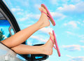 Female legs in pink sandals out from the car summer trip concept Stock Photography