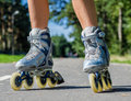 Female legs in roller blades Royalty Free Stock Photo