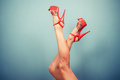 Female legs in stripper heels sexy wearing against a blue background Royalty Free Stock Photo