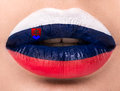 Female lips close up with a picture flag of Slovakia. Blue, white, red..