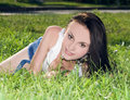 Female lying on grass field at the park Royalty Free Stock Photos