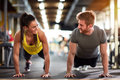Female and male compete in endurance Royalty Free Stock Photo