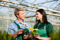 Female and male gardener in market garden Royalty Free Stock Photos