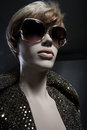 Female mannequin in a dress wig and glasses portrait of glittering sunglasses park Stock Images