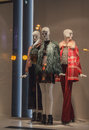 Female mannequins in a shop window on the coat