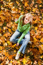 Female on maple leaves Stock Photos