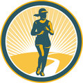 Female marathon runner circle retro illustration of triathlete running winning finishing race viewed from front set inside on Royalty Free Stock Images