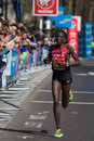 Female marathon runner london uk april edna kiplagat from kenya competing at the virgin london pictured close to miles she Stock Images