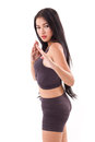 Female martial artist assuming kungfu fighting stance Royalty Free Stock Photo