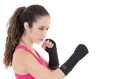 Female mixed martial arts fighter in mma style gloves strikes a fight stance this image has attached release Royalty Free Stock Photos