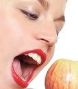 Female model biting an apple